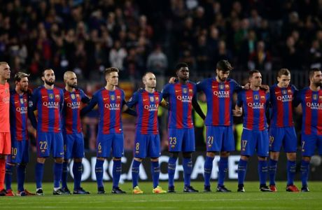FC Barcelona players stand for a minute of silence for the victims of the plane crash in Colombia carrying Chapecoense soccer team members, before the Champions League, Group C, soccer match between FC Barcelona and Borussia Moenchengladbach at the Camp Nou stadium in Barcelona, Spain, Tuesday Dec. 6, 2016. (AP Photo/Manu Fernandez)
