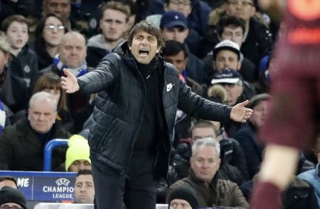 Chelsea head coach Antonio Conte reacts during the Champions League, round of 16, first-leg soccer match between Chelsea and Barcelona at Stamford Bridge stadium, Tuesday, Feb. 20, 2018. (AP Photo/Frank Augstein)