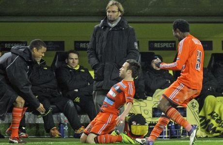 Marseille's Mathieu Valbuena, on the ground, celebrates in front of Dortmund head coach Juergen Klopp after scoring the decisive goal during the Champions League Group F soccer match between Borussia Dortmund and Olympique Marseille in Dortmund, Germany, Tuesday, Dec. 6, 2011. Dortmund was defeated by Marseille 2-3.  (AP Photo/Martin Meissner)
