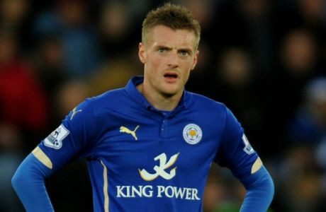 FILE - In this Saturday Dec. 13, 2014 file photo, Leicester's Jamie Vardy looks up during the English Premier League soccer match between Leicester City and Manchester City at King Power Stadium, in Leicester, England. England striker Jamie Vardy has apologized after he was filmed allegedly using racist language in a casino on a night out. (AP Photo/Rui Vieira, File)