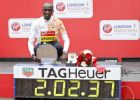 Winner of the men's race Kenya's Eliud Kipchoge poses next to his race time at the 39th London Marathon in London, Sunday, April 28, 2019. (AP Photo/Alastair Grant)
