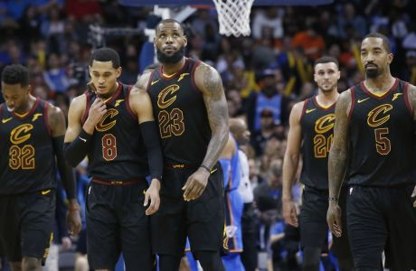 Cleveland Cavaliers forward Jeff Green (32), guard Jordan Clarkson (8), forward LeBron James (23), forward Larry Nance Jr. (24) and J.R. Smith (5) walk off the court during a time out in the second half of an NBA basketball game against the Oklahoma City Thunder in Oklahoma City, Tuesday, Feb. 13, 2018. (AP Photo/Sue Ogrocki)