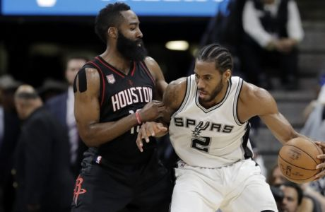 Houston Rockets' James Harden defends as San Antonio Spurs forward Kawhi Leonard (2) positions for a shot during Game 2 in a second-round NBA basketball playoff series, Wednesday, May 3, 2017, in San Antonio. (AP Photo/Eric Gay)