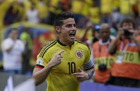 Colombia's James Rodriguez celebrates scoring his side's first goal against Bolivia during a 2018 World Cup qualifying soccer match at the Roberto Melendez stadium in Barranquilla, Colombia, Thursday, March 23, 2017. (AP Photo/Ricardo Mazalan)