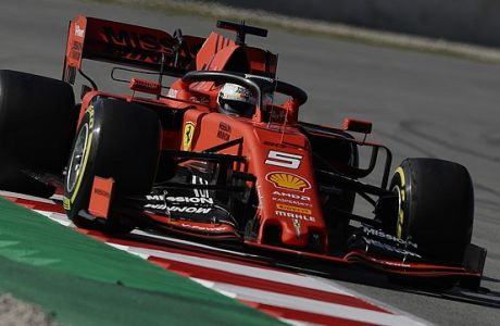 Ferrari driver Sebastian Vettel of Germany steers his car during a Formula One pre-season testing session at the Barcelona Catalunya racetrack in Montmelo, outside Barcelona, Spain, Monday, Feb.18, 2019. (AP Photo/Manu Fernandez)