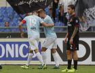 Lazio's Ciro Immobile, center, celebrates with his teammate Senad Lulic after scoring as AC Milan's Davide Calabria looks on, during a Serie A soccer match between Lazio and AC Milan, at the Rome Olympic stadium, Sunday, Sept. 10, 2017. (AP Photo/Alessandra Tarantino)