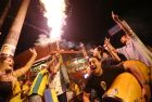 SAO PAULO, BRAZIL - JUNE 12:  Brazilians celebrate in Vila Madalena while launching a firework moments after Brazil won their opening match over Croatia on June 12, 2014 in Sao Paulo, Brazil. This is the first day of the 2014 FIFA World Cup.  (Photo by Mario Tama/Getty Images)