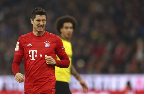 Bayern's Robert Lewandowski reacts after missing a chance to score during the German Bundesliga soccer match between FC Bayern Munich and Borussia Dortmund, in Munich, Germany, Saturday, Nov. 9, 2019. (AP Photo/Matthias Schrader)