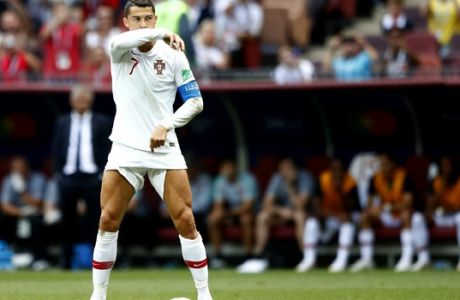Portugal's Cristiano Ronaldo waits for a free kick during the group B match between Portugal and Morocco at the 2018 soccer World Cup in the Luzhniki Stadium in Moscow, Russia, Wednesday, June 20, 2018. (AP Photo/Matthias Schrader)