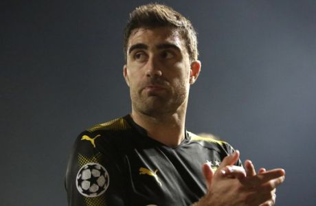 Dortmund's Sokratis leaves the pitch after the Champions League Group H soccer match between APOEL Nicosia and Borussia Dortmund at GSP stadium, in Nicosia, Cyprus, on Tuesday, Oct. 17, 2017. (AP Photo/Petros Karadjias)
