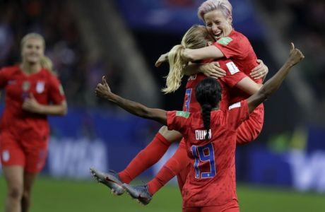United States' scorer Samantha Mewis lifts her teammate Megan Rapinoe as she celebrates her side's 4rth goal during the Women's World Cup Group F soccer match between United States and Thailand at the Stade Auguste-Delaune in Reims, France, Tuesday, June 11, 2019. (AP Photo/Alessandra Tarantino)