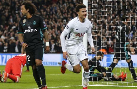 Tottenham's Dele Alli, right, celebrates after scoring the opening goal during the soccer Champions League group H match between Tottenham and Real Madrid in London, Wednesday, Nov. 1, 2017. (AP Photo/Frank Augstein)