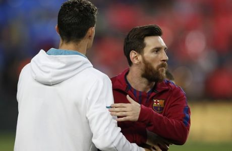 Barcelona's Lionel Messi, right and Real Madrid's Cristiano Ronaldo greets each other before a Spanish La Liga soccer match between Barcelona and Real Madrid, dubbed 'el clasico', at the Camp Nou stadium in Barcelona, Spain, Sunday, May 6, 2018. (AP Photo/Manu Fernandez)