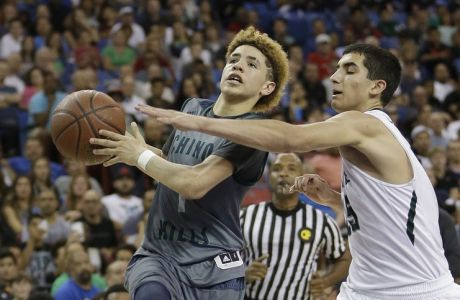 Chino Hills' Lamelo Ball, left, goes to the basket against De La Salle's Jordan Ratinho during the second half of the CIF boys' Open Division high school basketball championship game Saturday, March 26, 2016, in Sacramento, Calif. Chino Hills won 70-50. (AP Photo/Rich Pedroncelli)