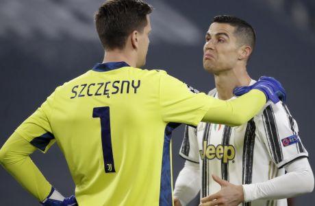 Στσέζνι και Ρονάλντο στη διάρκεια της ρεβάνς Γιουβέντους-Πόρτο στο 'Allianz Stadium', για την φάση των 16 του Champions League. Οι Πορτογάλοι πήραν την πρόκριση με το συνολικό 4-4, χάρη στα εκτός έδρας γκολ | 09/03/2021 (AP Photo/Luca Bruno)