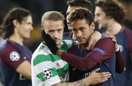 Celtic's Leigh Griffiths, left, is conforted by PSG's Neymar at the end of a Champions League Group B soccer match between Paris St. Germain and Celtic at the Parc des Princes stadium in Paris, France, Wednesday, Nov. 22, 2017. PSG defeated Celtic Glasgow 7-1. (AP Photo/Christophe Ena)