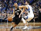 San Antonio Spurs' Tony Parker, left, of France gets tangled up with Minnesota Timberwolves' Ricky Rubio of Spain during the first half of an NBA basketball game Tuesday, March 21, 2017, in Minneapolis. (AP Photo/Jim Mone)