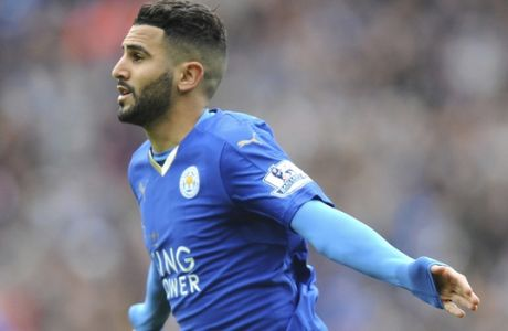 FILE- In this Sunday, April 24, 2016 file photo, Leicester's Riyad Mahrez celebrates after scoring during the English Premier League soccer match between Leicester City and Swansea City at the King Power Stadium in Leicester, England. Mahrez says in a statement released by his management company on Tuesday, May 30, 2017, he wants to leave Leicester, a year after helping the team to win the English Premier League.  (AP Photo/Rui Vieira, File)