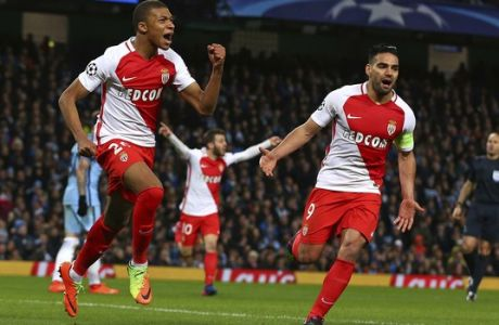 Monaco's Kylian Mbappe, left, celebrates with Radamel Falcao after scoring his side's second goal during the Champions League round of 16 first leg soccer match between Manchester City and Monaco at the Etihad Stadium in Manchester, England, Tuesday Feb. 21, 2017. (AP Photo/Dave Thompson)