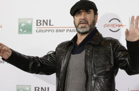 Actor and former soccer star Eric Cantona poses for photographers during the photo call of the movie Les Rois du Monde/Mad Kings, at Rome's Film Festival, in Rome, Monday, Oct. 19, 2015. (AP Photo/Andrew Medichini)