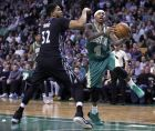 Boston Celtics guard Isaiah Thomas (4) drives to the basket against Minnesota Timberwolves center Karl-Anthony Towns (32) during the second quarter of an NBA basketball game in Boston, Wednesday, March 15, 2017. (AP Photo/Charles Krupa)