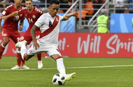 Peru's Christian Cueva, right, fails to score on a penalty kick during the group C match between Peru and Denmark at the 2018 soccer World Cup in the Mordovia Arena in Saransk, Russia, Saturday, June 16, 2018. (AP Photo/Martin Meissner)
