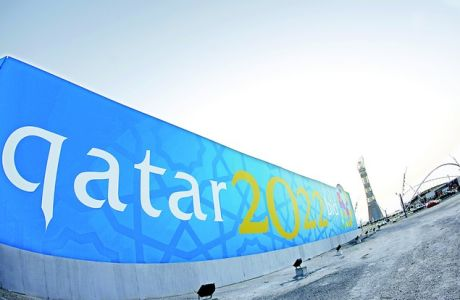 TO GO WITH AFP STORY BY FRANCOISE CHAPTAL  (FILES)  -- File picture dated March 22, 2010 shows a banner for Qatar's 2022 bid to host the World Cup is seen near Aspire athletics zone in Doha. The gulf emirate, future host of the 2022 FIFA World Cup and past playground of several Arab and Asian games, is reaching for the moon as it eyes the 2020 Olympics despite seemingly insurmountable climate challenges.     AFP PHOTO/KARIM JAAFAR