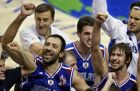 Yugoslavia's Vlade Divac, left, and Marko Jaric celebrate their 84-77 win over Argentina in the Gold Medal game of the World Basketball Championships in Indianapolis, Sunday, Sept. 8, 2002. (AP Photo/Michael Conroy)