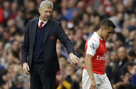 Arsenal's French manager Arsene Wenger pats Alexis Sanchez as he leaves the pitch after being substituted during the English Premier League soccer match between Arsenal and Watford at the Emirates Stadium in London, Saturday, April 2, 2016.  (AP Photo/Matt Dunham)