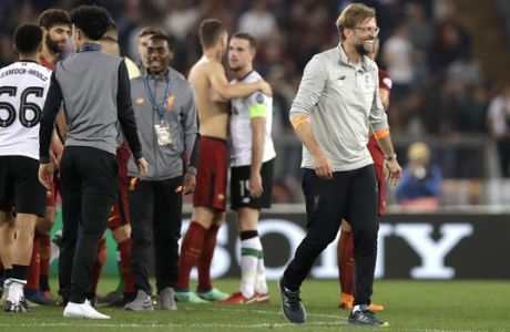 Liverpool coach Jurgen Klopp smiles at the end of the Champions League semifinal second leg soccer match between Roma and Liverpool at the Olympic Stadium in Rome, Wednesday, May 2, 2018. (AP Photo/Alessandra Tarantino)