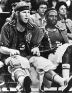 Portland Trail Blazers Bill Walton applies ice packs to his knees on the bench during second quarter action in their game with Atlanta, in Atlanta, Jan. 11, 1976. The Blazers, led by Walton, defeated the Hawks 116-109. Next to Walton is teammate Sidney Wicks. (AP Photo/Joe Holloway Jr.)