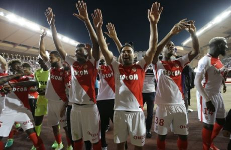 Monaco players celebrate their French League One title after beating Saint Etienne during the League One soccer match Monaco against Saint Etienne, at the Louis II stadium in Monaco, Wednesday, May 17, 2017. Monaco clinched its first league title since 2000 and eighth overall, replacing Paris Saint-Germain as champion. (AP Photo/Claude Paris)