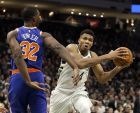 Milwaukee Bucks' Giannis Antetokounmpo, right, drives past New York Knicks' Noah Vonleh during the second half of an NBA basketball game Monday, Oct. 22, 2018, in Milwaukee. (AP Photo/Aaron Gash)