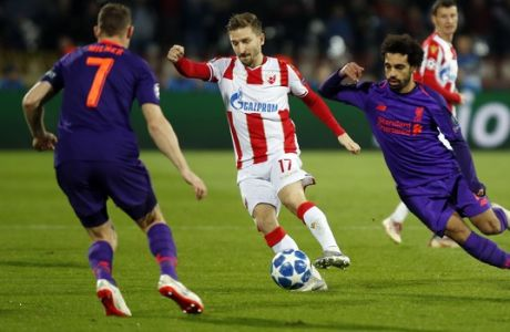 Red Star's Marko Marin, center, vies the ball past Liverpool midfielder James Milner, left, and Liverpool forward Mohamed Salah, right, during the Champions League group C soccer match between Red Star and Liverpool at the Rajko Mitic stadium in Belgrade, Serbia, Tuesday, Nov. 6, 2018. (AP Photo/Marko Drobnjakovic)