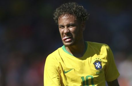 Brazil's Neymar reacts during a friendly soccer match between Brazil and Croatia at Anfield Stadium in Liverpool, England, Sunday, June 3, 2018. (AP Photo/Dave Thompson)