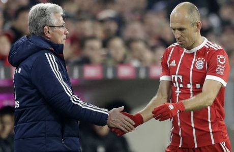 Bayern's Arjen Robben, right, touches hands with coach Jupp Heynckes after his substitution during the German Soccer Bundesliga match between FC Bayern Munich and FC Augsburg in Munich, Germany, Saturday, Nov. 18, 2017. (AP Photo/Matthias Schrader)