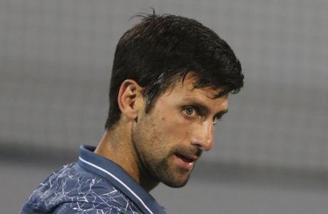 Serbia's Novak Djokovic reacts in a semi final match against Russia's Karen Khachanov, during the Mubadala World Tennis Championship in Abu Dhabi, United Arab Emirates, Friday, Dec. 28, 2018. (AP Photo/Kamran Jebreili)