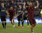 Roma's Daniele De Rossi celebrates after his teammate Kostas Manolas scored during a Serie A soccer match between Roma and Inter Milan, at Rome's Olympic Stadium, Sunday, Oct. 2, 2016. (AP Photo/Andrew Medichini)