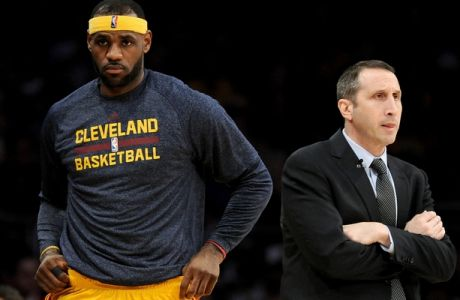 LOS ANGELES, CA - JANUARY 15:  LeBron James #23 of the Cleveland Cavaliers returns to the court behind Head Coach David Blatt of the Cleveland Cavaliers during a 109-102 win over the Los Angeles Lakers at Staples Center on January 15, 2015 in Los Angeles, California.  NOTE TO USER: User expressly acknowledges and agrees that, by downloading and or using this Photograph, user is consenting to the terms and condition of the Getty Images License Agreement.  (Photo by Harry How/Getty Images)