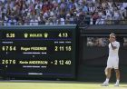 Switzerland's Roger Federer stands next to the scoreboard after losing his men's quarterfinals match against Kevin Anderson of South Africa, at the Wimbledon Tennis Championships, in London, Wednesday July 11, 2018. (AP Photo/Ben Curtis)