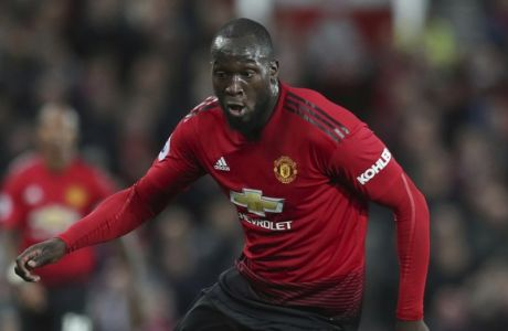 Manchester United's Romelu Lukaku takes the bal forward during their English Premier League soccer match between Manchester United and Newcastle United at Old Trafford in Manchester, England, Saturday, Oct. 6, 2018. (AP Photo/Jon Super)