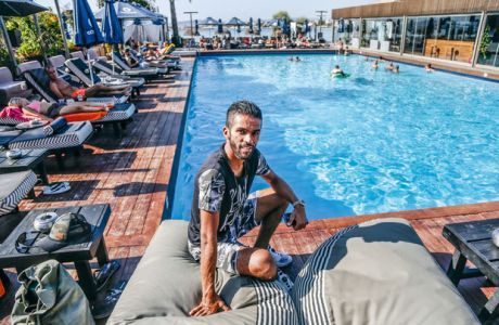 Mehdi François Carcela-González, Moroccan-Belgian professional footballer who plays as a midfielder for Greek club Olympiacos, poses for a picture next to a pool at Balux Café, in Glyfada district of Athens, Greece, September 14, 2017. PHOTO/YANNIS KOLESIDID