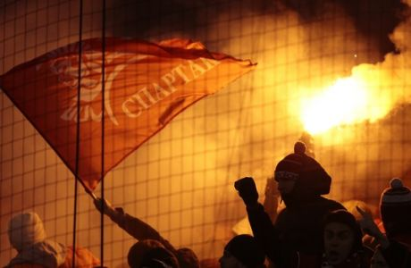 Spartak fans fire flares during the national championship soccer match between Spartak and CSKA in Moscow, Russia, on Saturday, Oct. 29, 2016. Crowd trouble marred a Moscow derby between arch-rivals Spartak and CSKA on Saturday, with the game briefly stopped as flares were thrown. The referee halted the match for five minutes in the second half as the stadium filled with smoke from flares and other pyrotechnics, some of which were thrown into sections packed with fans. (AP Photo/Ivan Sekretarev)