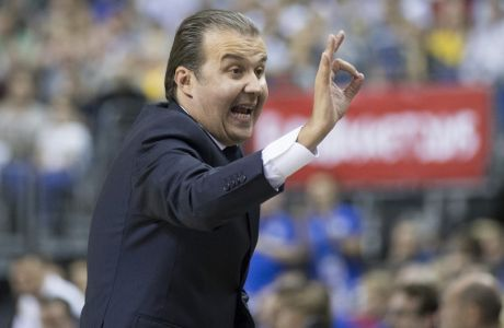 Italy's coach Simone Pianigiani follows the match during the EuroBasket European Basketball Championship group B match between Italy and Germany in Berlin, Germany, Wednesday, Sept. 9, 2015. (AP Photo/Axel Schmidt)