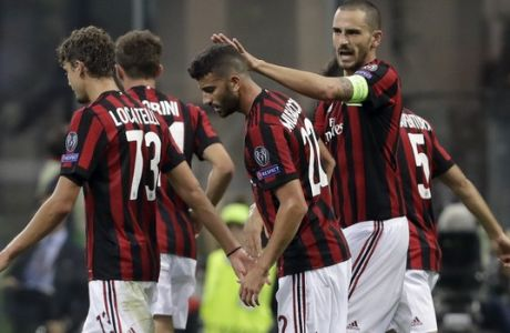 AC Milan's Mateo Musacchio, 2nd right, is congratulated by Leonardo Bonucci after scoring his side's second goal, during the Europa League group D soccer match between AC Milan and Rijeka, at the Milan San Siro Stadium, Italy, Thursday, Sept. 28, 2017. (AP Photo/Luca Bruno)