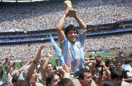 FILE - This is a June 29, 1986  file photo  of  Diego Maradona of Argentina celebrates with the cup at the end of the World Cup soccer final in the Atzeca Stadium, in Mexico City, Mexico. Argentina defeated West Germany 3-2 to take the trophy.   With one week to go before the World Cup starts in Brazil, The Associated Press takes a look at 10 great stars in the tournament's history. Maradona One the greatest playmakers of all time, Maradona was joint FIFA Player of the 20th Century with Pele. El Pibe de Oro inspired Argentina to victory in the 1986 tournament. The English will never forgive him for his Hand of God goal en route to winning the World Cup. And perhaps his own people, the Argentines, will never forgive him for being a terrible coach for the national team at the World Cup four years ago in South Africa. But as player, Maradona was peerless during his heyday, although drug problems marred the end of his career. (AP Photo/Carlo Fumagalli, File)