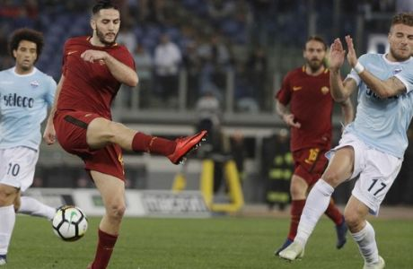 Lazio's Ciro Immobile, right, and Roma's Kostas Manolas vie for the ball during an Italian Serie A soccer match between AS Roma and Lazio, at the Olympic stadium in Rome, Sunday, April 15, 2018. (AP Photo/Gregorio Borgia)
