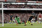 Arsenal goalkeeper Petr Cech, center, stops a shot from Manchester City's Aymeric Laporte, center right, during the English Premier League soccer match between Arsenal and Manchester City at the Emirates stadium in London, England, Sunday, Aug. 12, 2018. (AP Photo/Tim Ireland)