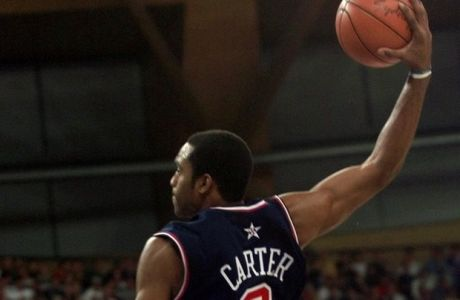 United States' Vince Carter goes over the top of France's Frederic Weis in the second half of their game at the Dome during the 2000 Summer Olympics in Sydney, Monday, Sept. 25, 2000. Carter scored 13 points as the United State defeated France 106-94. (AP Photo/Dusan Vranic)