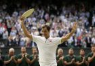 Switzerland's Roger Federer holds the runner up trophy after losing to Serbia's Novak Djokovic in the men's singles final match of the Wimbledon Tennis Championships in London, Sunday, July 14, 2019. (AP Photo/Tim Ireland)